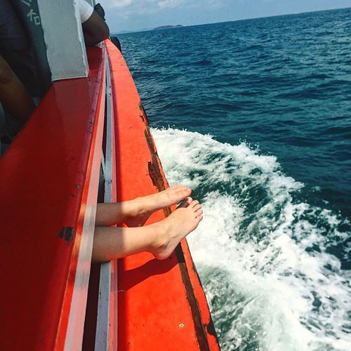 Low section of person in boat on sea