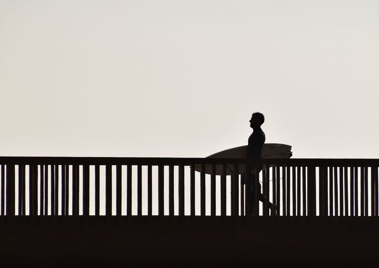 Railing One Person Silhouette Adult People Lifestyles Real People Day Outdoors Young Adult Surf Goes Surfer Surf Photography Surf Life Surfing Life Surfphotography