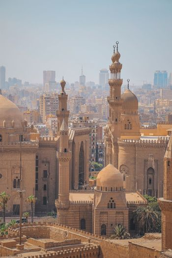 Mosque panoramic view of buildings in city against sky cairo egypt