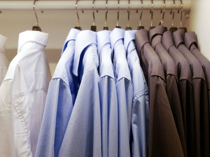 Clothes drying on rack in store