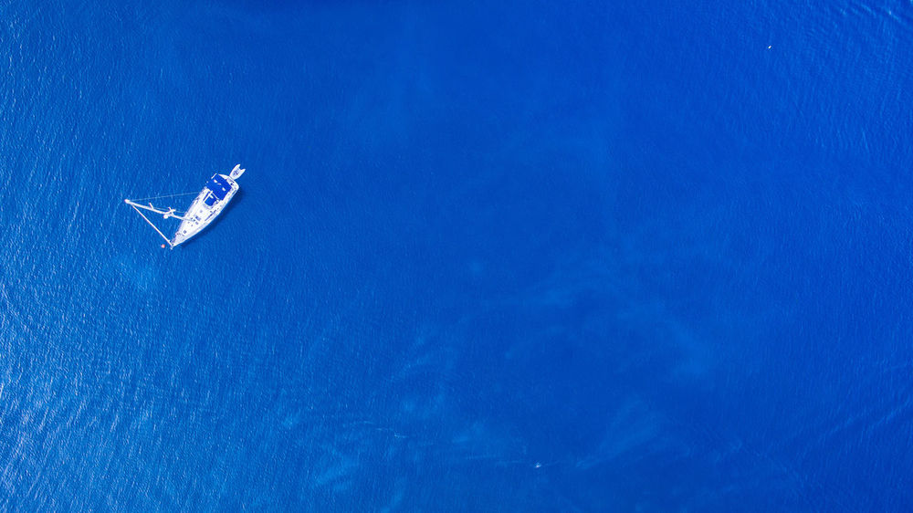 Lonely boat in the sea Perspectives On Nature Phantom 4 Relaxing Beauty In Nature Blue Dji Nature Sailing Sea Summer Transportation Water Go Higher