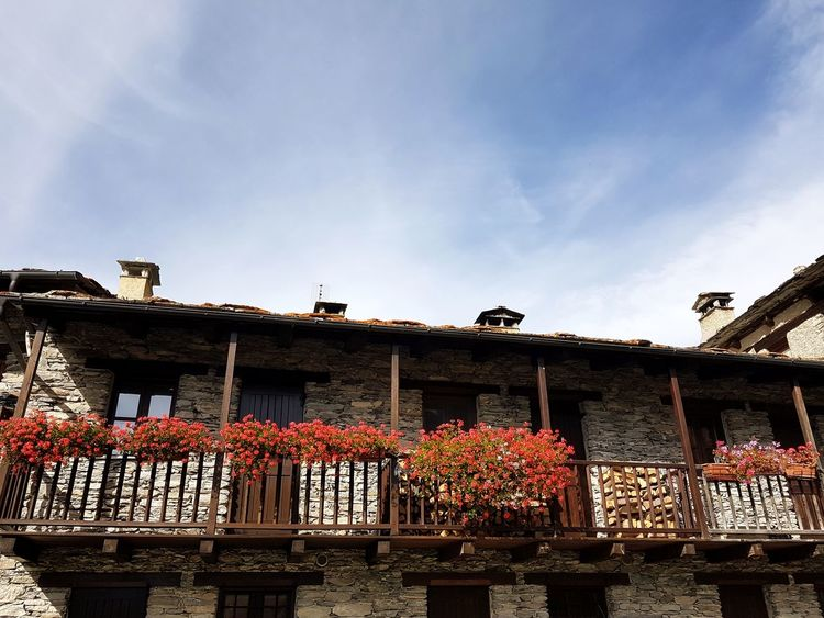 Mountain House Flowered Balcony Balcony In Bloom Mountain Range Red Flowers Stone House Day Sky Outdoors No People