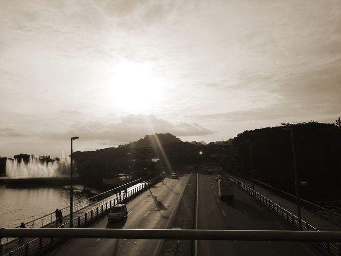 Bridge over road against sky in city