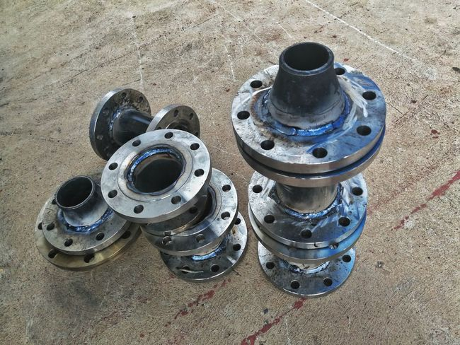 Welding flange and fitting of water pipe system. Pipe - Tube Pipeline Piping Work Welded Flange Workshop Construction Site Building High Angle View Nut - Fastener Pipe Tap Screw Bolt Water Pipe