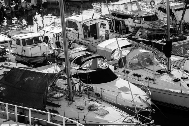 High angle view of damaged boats moored in city