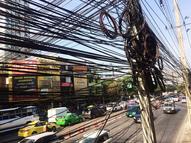 Cable Transportation Mode Of Transport City Land Vehicle Architecture Traffic Building Exterior Power Line  Cable Car Built Structure Road Outdoors City Life Sky Tree Day No People Tangle