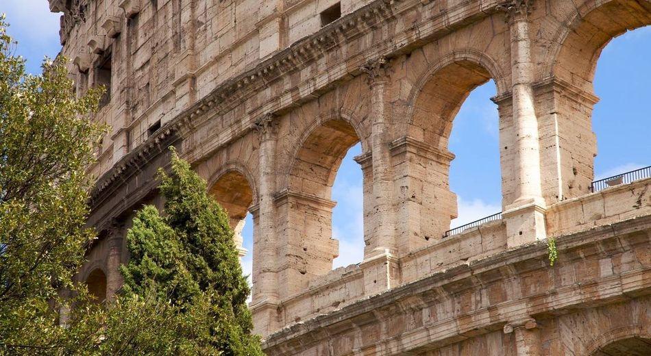 Partial view external facade of Colosseo (Anfiteatro Flavio) of Rome