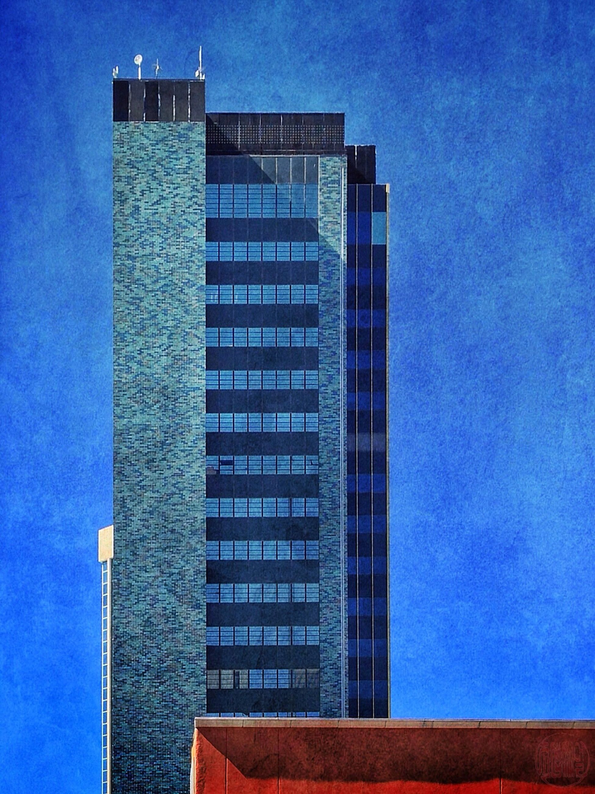 architecture, building exterior, built structure, low angle view, blue, building, clear sky, sky, tall - high, tower, modern, city, window, sunlight, outdoors, office building, no people, day, exterior, tall