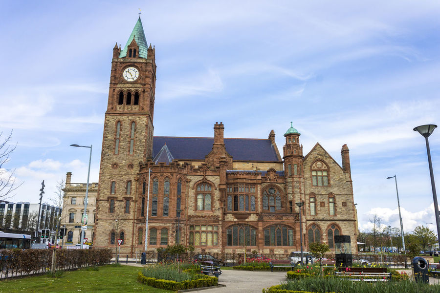 The Guildhall, a building built in 1890 in which the elected members of Derry and Strabane District Council meet. Derry, County Londonderry, Northern Ireland Northern Ireland Architecture Building Exterior Built Structure City Clock Clock Tower Cloud - Sky Day Derry Grass Guildhall History Londonderry No People Outdoors Place Of Worship Religion Sky Tower Travel Destinations