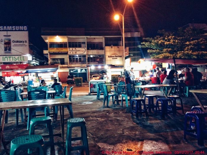 EyeEmNewHere Stall Chair Cafe Table Night Drink Establishment Pontianak IPhoneography Sidewalk Cafe Illuminated Sitting Large Group Of People Group Of People Eating Women Men Food Architecture Outdoors City People Adult