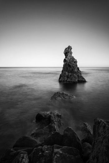 Sea Rock - Object Horizon Over Water Water Tranquility Scenics Beauty In Nature Nature No People Beach Outdoors Landscape Day Sky Cliff Travel Destinations Italy🇮🇹 Long Exposure Stones Rocks Beauty In Nature