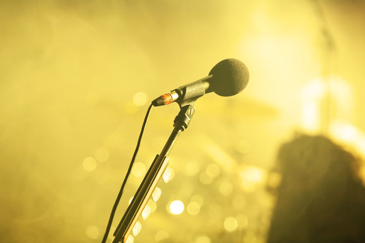 Arts Culture And Entertainment Close-up Day Illuminated Indoors  Microphone Microphone Stand Music Musical Instrument No People Singing Spotlight Stage - Performance Space Yellow