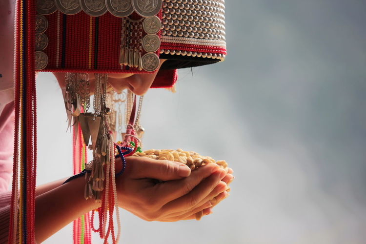 Close-Up Of Woman Holding Grains