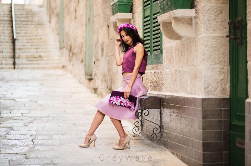 Full length of woman on pink umbrella