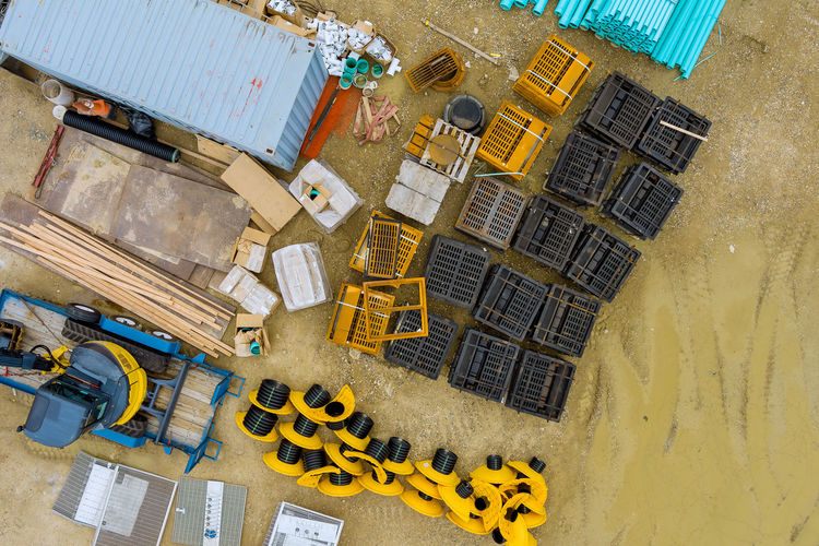 High angle view of yellow construction site by building