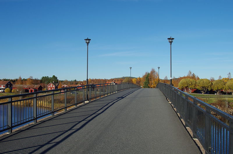 View Of Bridge Over Canal Against Blue Sky
