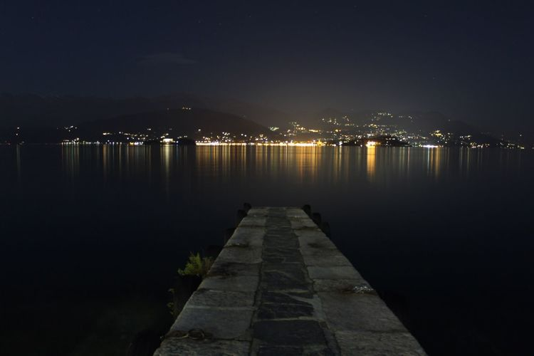 Night Illuminated Water Reflection Sky Built Structure Beauty In Nature Nature No People Outdoors Architecture Tranquil Scene Scenics Best  Best Shots EyeEm The City Light Mymountains_ Mountain Canon Miles Away Black Sea City Welcome To Black Break The Mold EyeEmNewHere