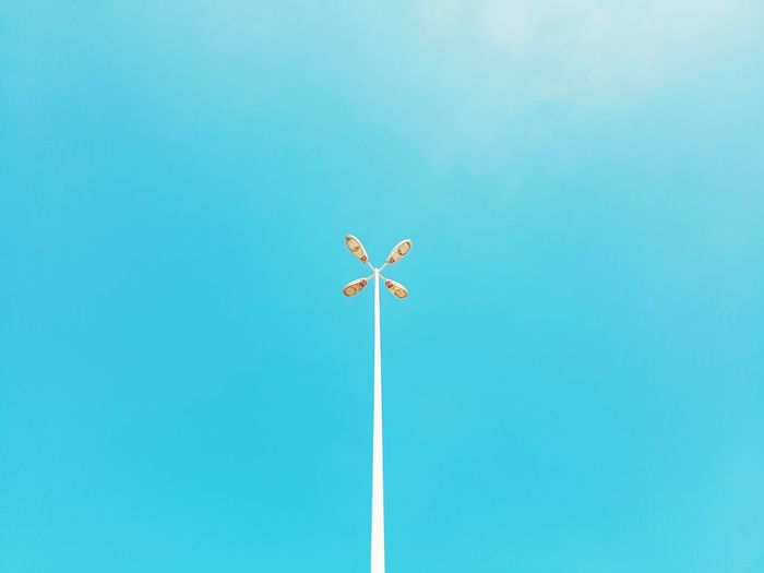 Blue Day Sky Low Angle View Clear Sky Wind Power Outdoors Wind Turbine No People Nature Vapor Trail Light Public Lighting Public Light Lighting Energy Electricity  Electricity Pylon