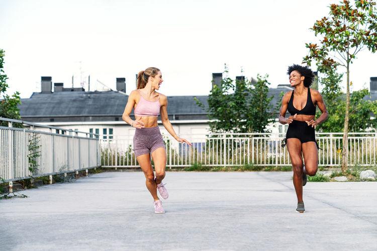 Full length of woman running on railing