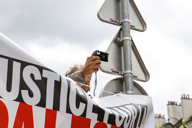 Man using camera during protest in city