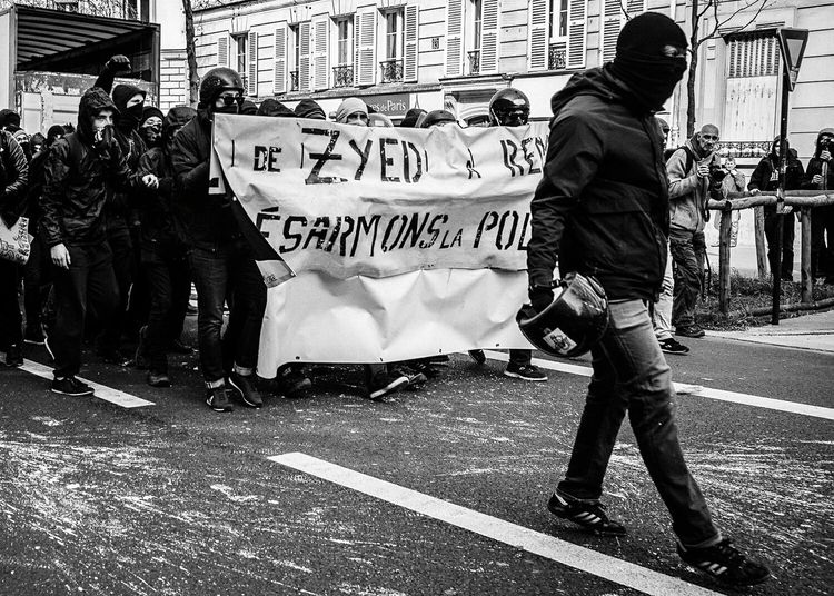 A protester leading the charge back towards the police. More than 200,000 people took to the streets all across France to voice their opposition against the labour law reforms that could potentially see their livelihoods threatened. Showcase April Black & White Black And White Photography Blackandwhite Sony A7RII EyeEm Masterclass EyeEm Gallery This Week On Eyeem Streetphotography France Paris Black And White Street Photography Riot Protest Streetphoto_bw Demonstration Reportagephotography Manif9avril Loitravail Reportagespotlight The Photojournalist - 2016 EyeEm Awards
