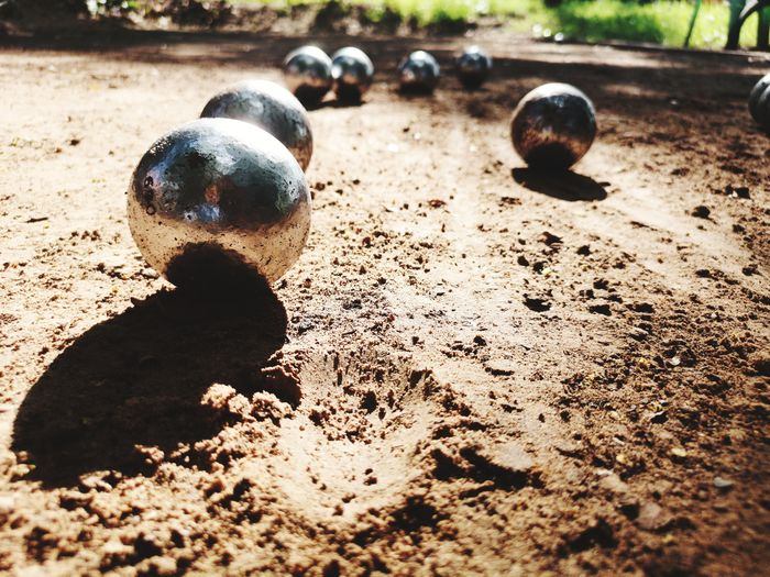 Close-up of metal ball on sand