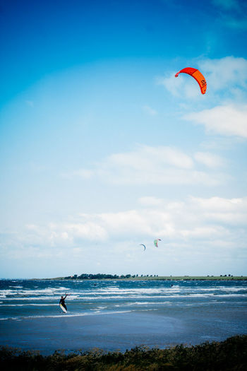 Adventure Blue Cloud - Sky Enjoyment Extreme Sports Fun Horizon Over Water Kiteboarding Leisure Activity Lifestyles Mid-air Scenics Sea Sky Sport Unrecognizable Person Vacations