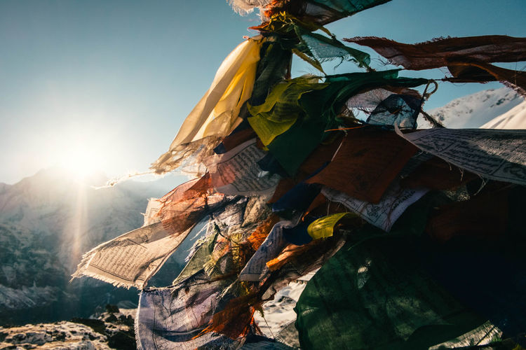 Annapurna Annapurna Base Camp Trek Nepal Beauty In Nature Day Flag Focus On Foreground Land Low Angle View Mountain Nature Pray Flag Sky Sun Sunbeam Sunlight