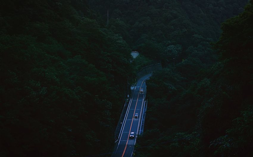 High angle view of cars on highway at dusk