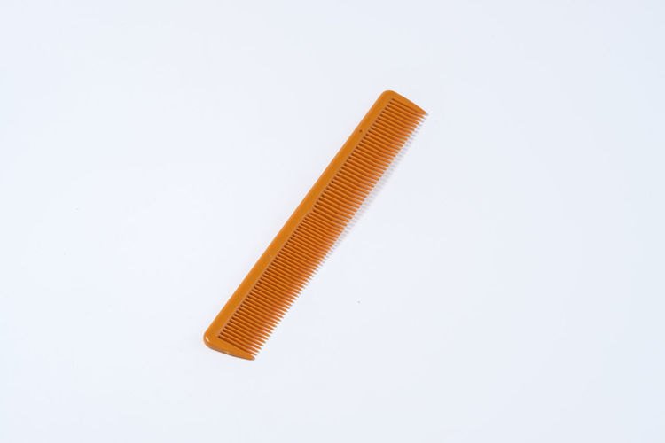Comb Comb Hair Fur Hair Neat Presentable Tidy White White Background Studio Shot Indoors  Cut Out Still Life Single Object Close-up Copy Space No People Orange Color Metal Pencil Equipment Yellow Directly Above High Angle View Simplicity Shape Security
