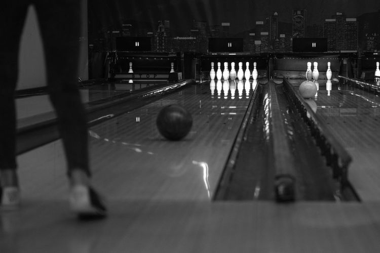 Go-west-photography.com Bowling Pins Sports Sport Indoors  Indoor Sports Blackandwhite Black And White Photography Illuminated Indoors  Team Sport Nightlife One Person One Person Standing Waiting