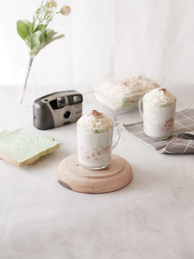 Close-up of ice cream served on table