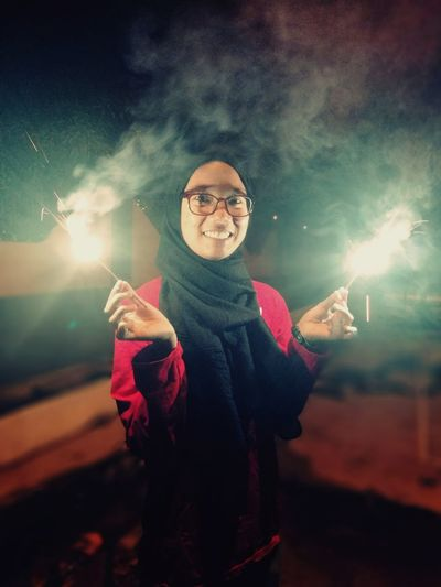 Face that describes enjoyment. Firecrackers Celebration Event Human Body Part Night Human Arm Looking At Camera Winter Portrait Fun People One Person Smiling EyeEm Ready   EyeEmNewHere