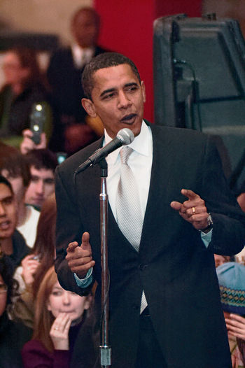 Barack Obama Crowds Obama Obama 2008 Speech Actor Adult Arts Culture And Entertainment Campaign Crowd Fame Film Industry Film Premiere Indoors  Lifestyles Men Microphone Music People Performance Presidential Campaign Standing Stump Speech Suit Tuxedo Young Adult