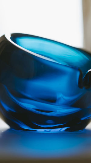 Close-up of blue glass on table