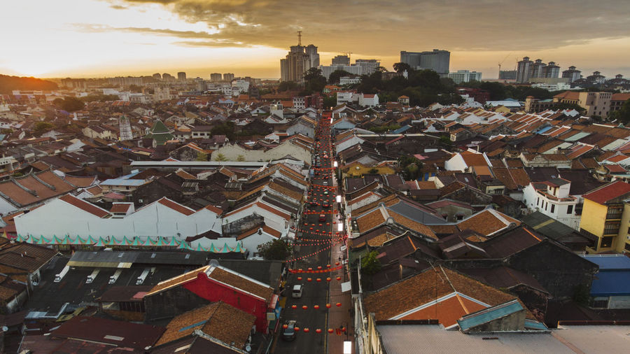 Morning aerial view of Melaka (Malacca) historic colonial town around Jonker street in Malaysia. Melaka Morning UNESCO World Heritage Site World Heritage Architecture Building Exterior Built Structure Chinese New Year Cityscape Cloud - Sky High Angle View House Malaysia Outdoors Red Lanterns Residential Building Roof Sky Skyscraper Sunrise Tourism Destination Travel Destinations