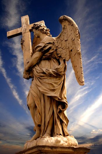 The Angel with the Cross statue on the Ponte Sant' Angelo in Rome Italy by Ercole Ferrata (1610 – 1686) Tourist Attraction  Travel Photography Angel Architecture Art And Craft Belief Blue Cloud - Sky Craft Europe Female Likeness Human Representation Low Angle View Nature No People Ponte Sant'Angelo Religion Representation Sculpture Sky Spirituality Statue Tourist Destination Travel Destination Travel Destinations