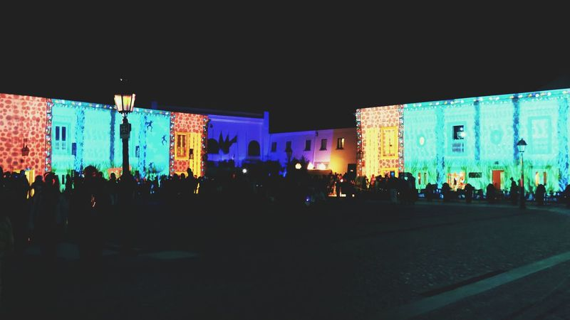 Night Illuminated Built Structure Architecture Outdoors Large Group Of People Building Exterior People City Cascais Portugal Luminale 2016 Lumina 2016-festival Da Luz Lumina Excitement Stage Light Event Enjoyment Nightlife Music Arts Culture And Entertainment Audience BYOPaper!