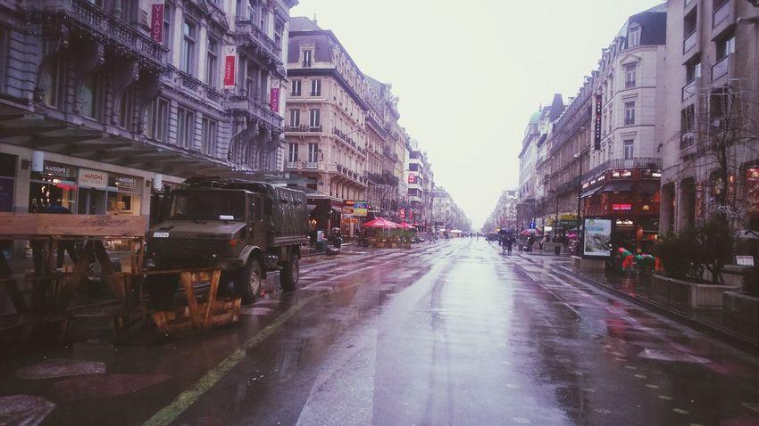 Boulevard Anspachwith Military Police ,under the Rain