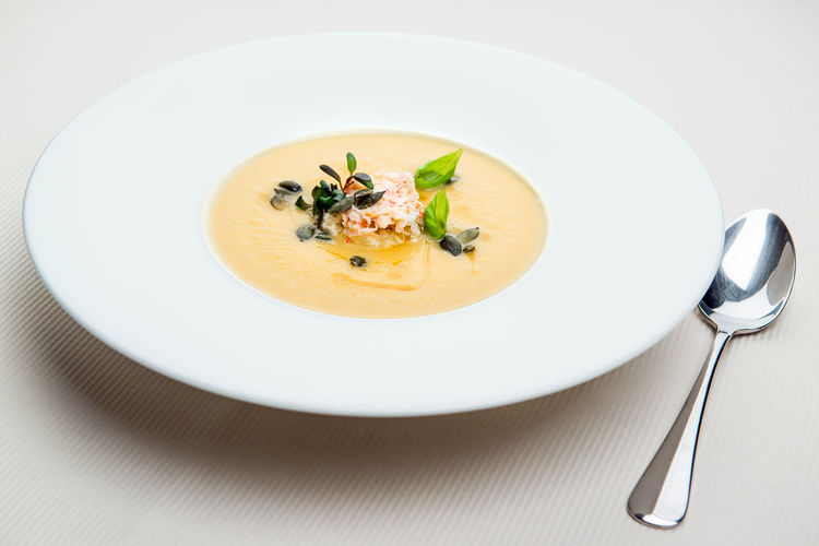 Pumpkin crab soup on a white bowl Cuisine Dinner Dinning Meal Time Pumpkin Soup Seafood Shrimp Soup Table Setting Appetizing  Close-up Delicacy Delicious Fish Soup Food Gourmet Main Course No People Nobody Plate Restaurant Restaurant Food Serving Dish Tasteful Tasty Thick Soup