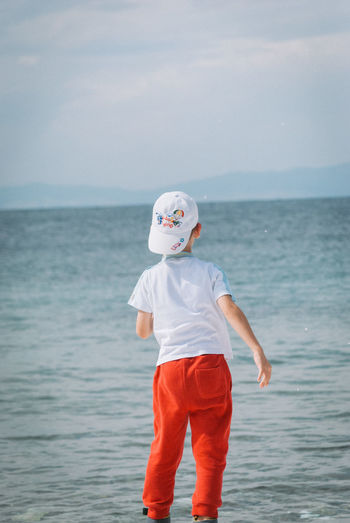 Boys Casual Clothing Childhood Day Horizon Over Water Leisure Activity Nature One Boy Only One Person Outdoors People Real People Sea Sky Standing Water