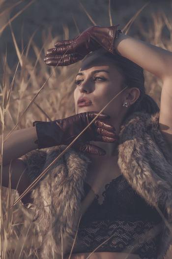Glamourous woman posing in field