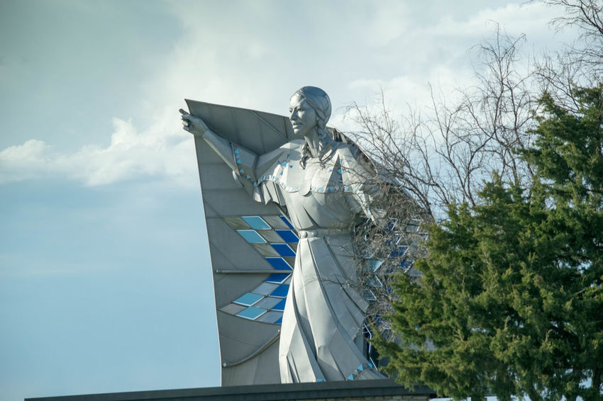 Dignity Native American Indian South Dakota Statue Architecture Art And Craft Building Exterior Built Structure Chamberlain Cloud - Sky Creativity Day Human Representation Low Angle View Male Likeness Native American Nature No People Outdoors Plant Religion Representation Sculpture Sky Statue Tree