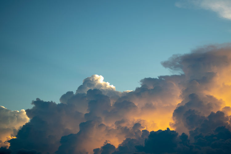 Sky Cloud - Sky Beauty In Nature Scenics - Nature Tranquil Scene Tranquility No People Sunset Copy Space Low Angle View Nature Idyllic Outdoors Day Sunlight Non-urban Scene Orange Color Blue Cloudscape