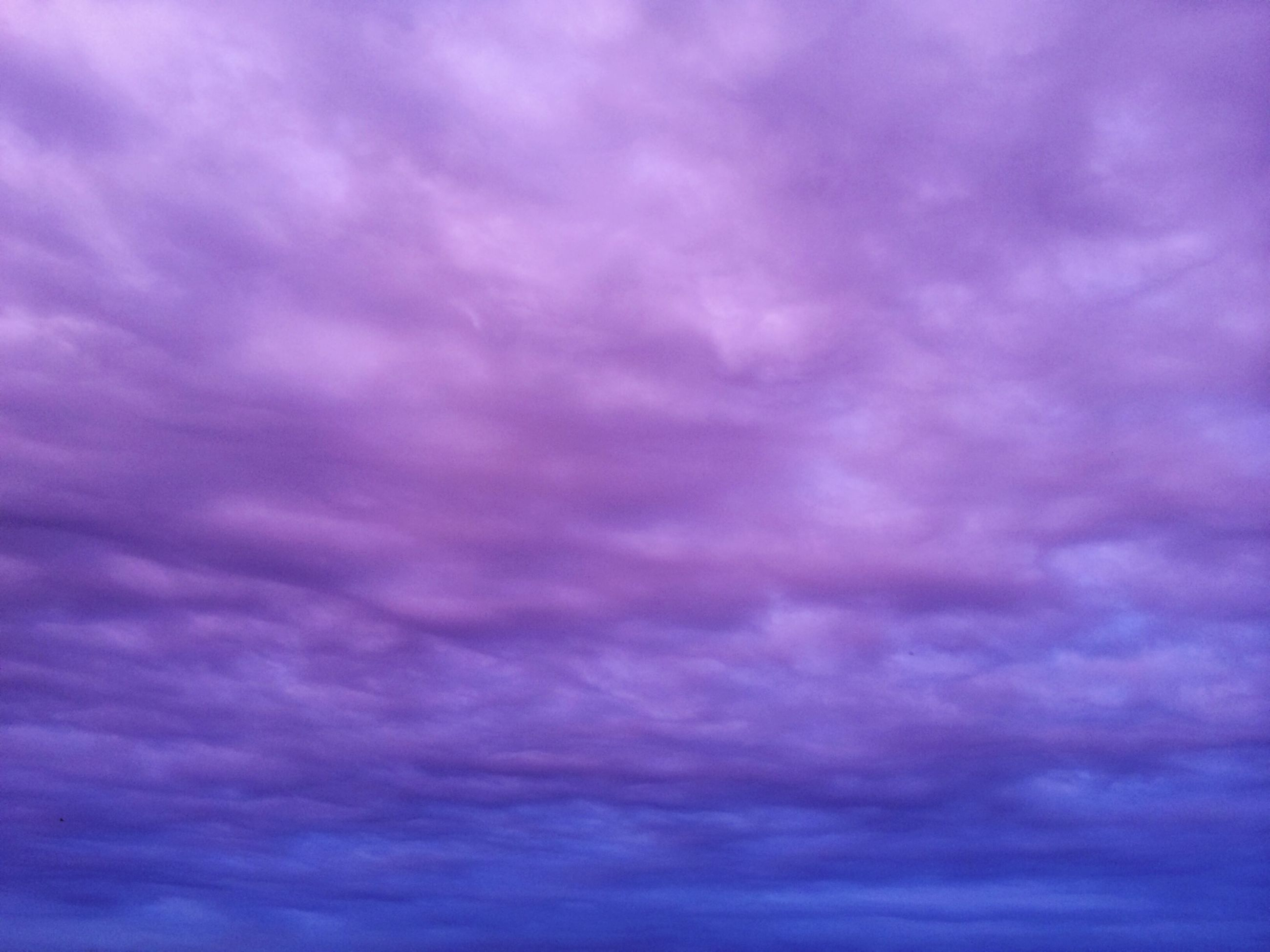 sky, cloud - sky, cloudy, low angle view, beauty in nature, scenics, tranquility, backgrounds, full frame, nature, cloudscape, sky only, tranquil scene, weather, dramatic sky, cloud, overcast, idyllic, purple, blue