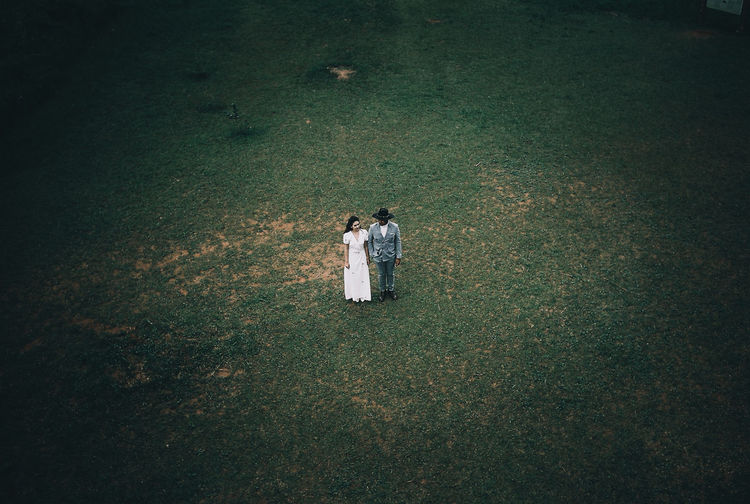High angle view of couple on field