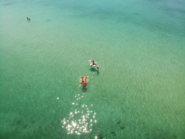Blue Sea Red Swimming Aerial View Air Mattress Beauty In Nature Day High Angle View Holiday Land Lilo Nature Nautical Vessel Outdoors Real People Scenics - Nature Sea Sunlight Tranquil Scene Tranquility Transportation Turquoise Colored Water Waterfront