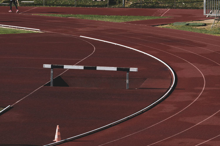 stadium running track hurdle Tartan Track Athletics Sport Running Stadium Competition Speed Lanes Hurdle Hedge Obstacles Wooden Track And Field Running Track Sports Track Absence Empty Curve High Angle View No People Red Outdoors The Way Forward Direction Sign Marking Dividing Line Steeplechase