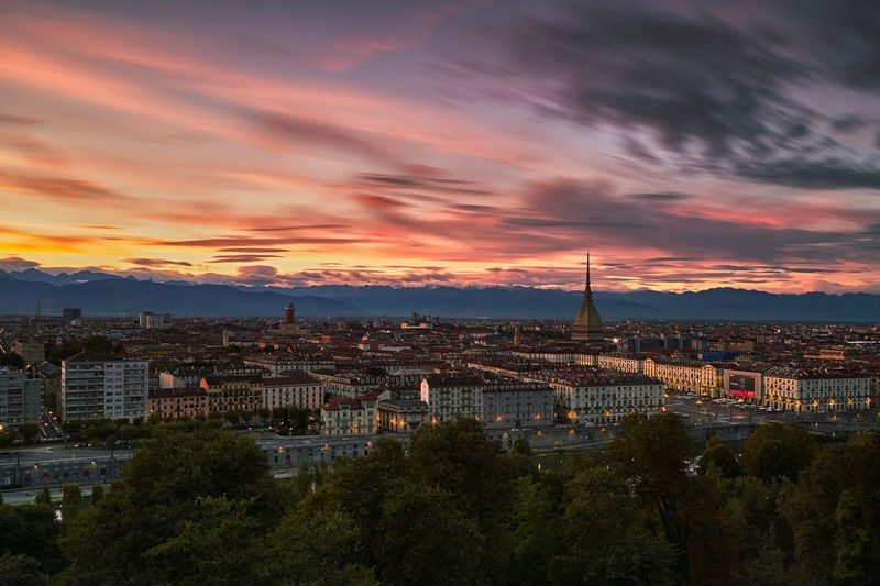 Turin, Italy. Architecture City Cityscape Sky Sunset Built Structure High Angle View Illuminated Cloud - Sky Dramatic Sky Outdoors Cloud Architecture City Built Structure Cityscape Building Exterior Sunset Sky High Angle View Cloud - Sky Tree Illuminated Scenics Travel Destinations