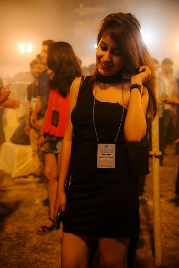 Young Woman In Dress Standing Outdoors At Night